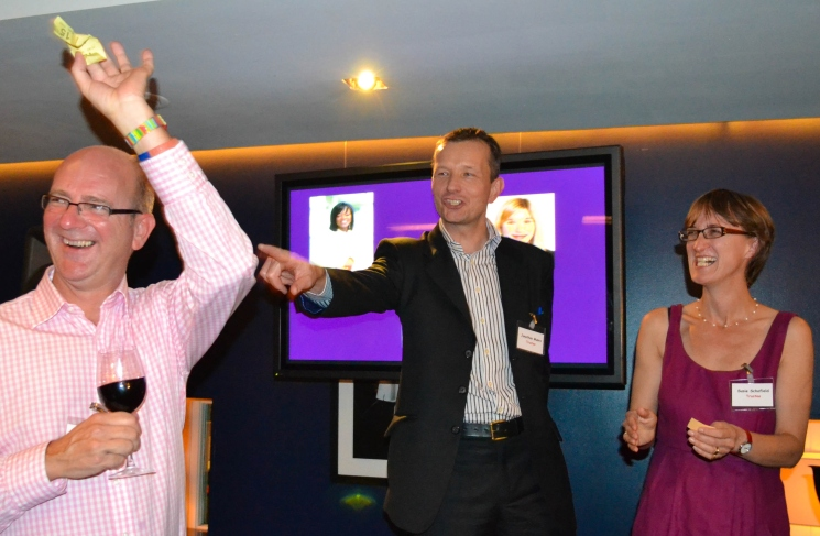 James Buchanan celebrates his raffle win with Trustees Jonathan Munro and Susie Schofield